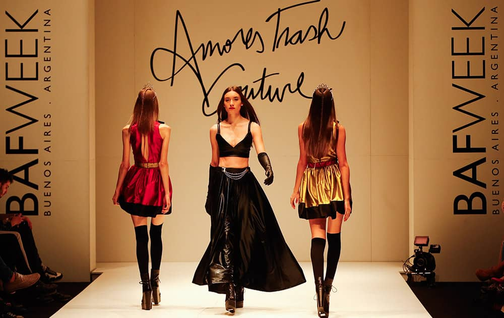 Models wear creations from the Amores Trash Couture collection during Buenos Aires fashion.