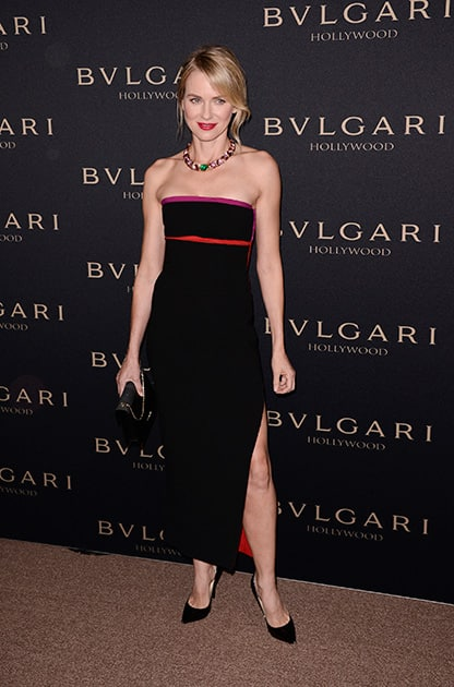 Actress and host Naomi Watts attends the BVLGARI Decades of Glamour Oscar Party at Soho House, in West Hollywood, Calif.