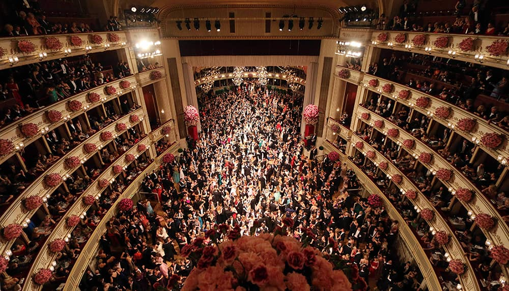 Dancers crowd the dance floor during traditional Opera Ball in Vienna, Austria.