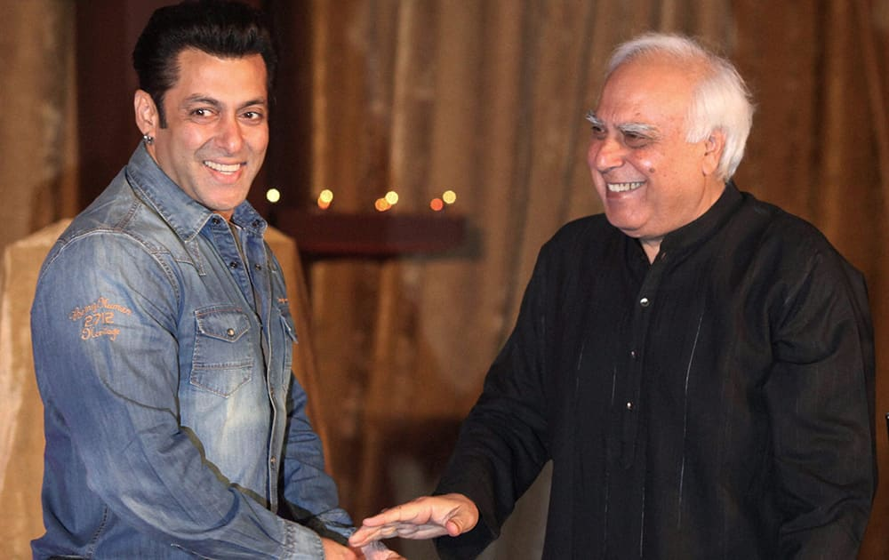 Union Law and IT Minister Kapil Sibal and actor Salman Khan at the launch of AR Rahman's music album 'Raunaq' in Mumbai. Sibal wrote lyrics for the seven songs in the album.