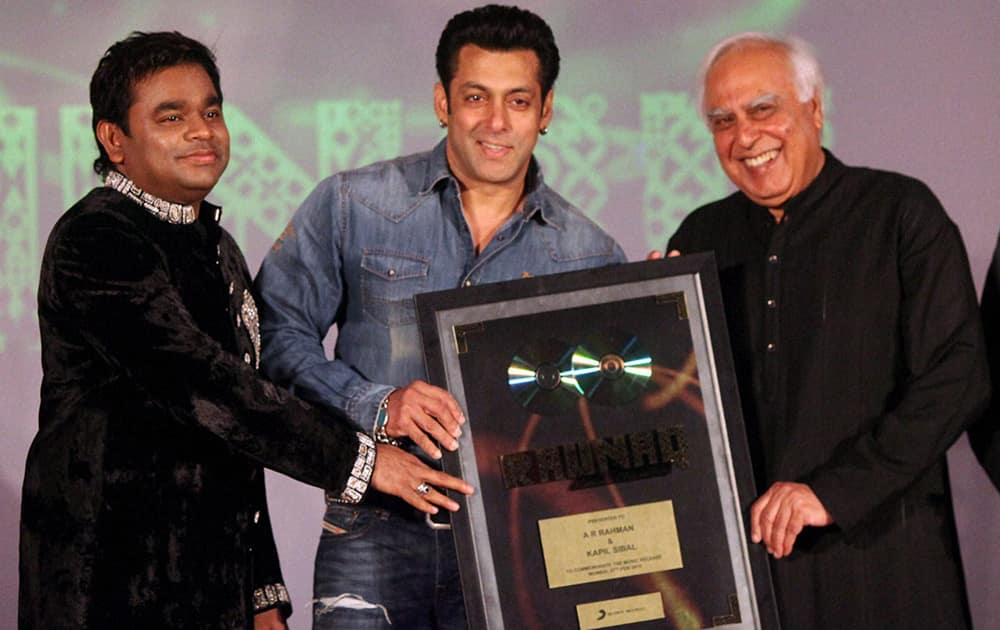 Union Law and IT Minister Kapil Sibal, actor Salman Khan and music composer A R Rahman at the launch of the latter's music album 'Raunaq' in Mumbai. Sibal wrote lyrics for the seven songs in the album.