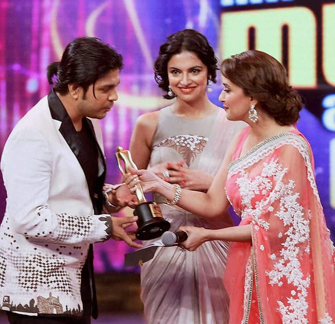 Madhuri Dixit presents award to a winner during the 6th Mirchi Music Awards 2014 in Mumbai.