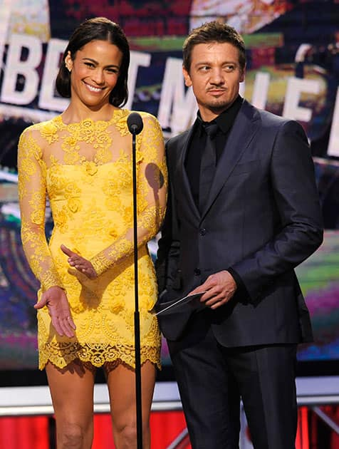 Paula Patton and Jeremy Renner speak on stage at the 2014 Film Independent Spirit Awards, in Santa Monica, Calif.