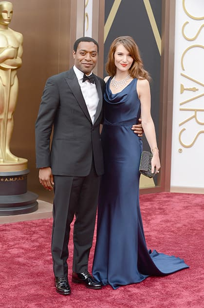 Chiwetel Ejiofor and Sari Mercer arrive at the Oscars, at the Dolby Theatre in Los Angeles.