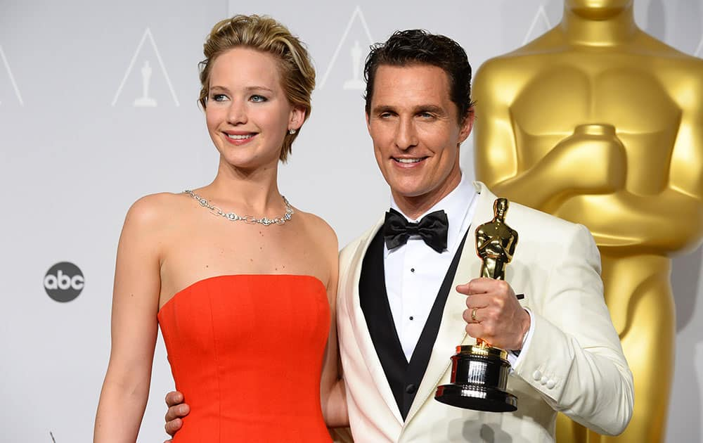 Matthew McConaughey, winner of the award for best actor for his role in the 'Dallas Buyers Club' poses with Jennifer Lawrence in the press room during the Oscars at the Dolby Theatre, in Los Angeles.