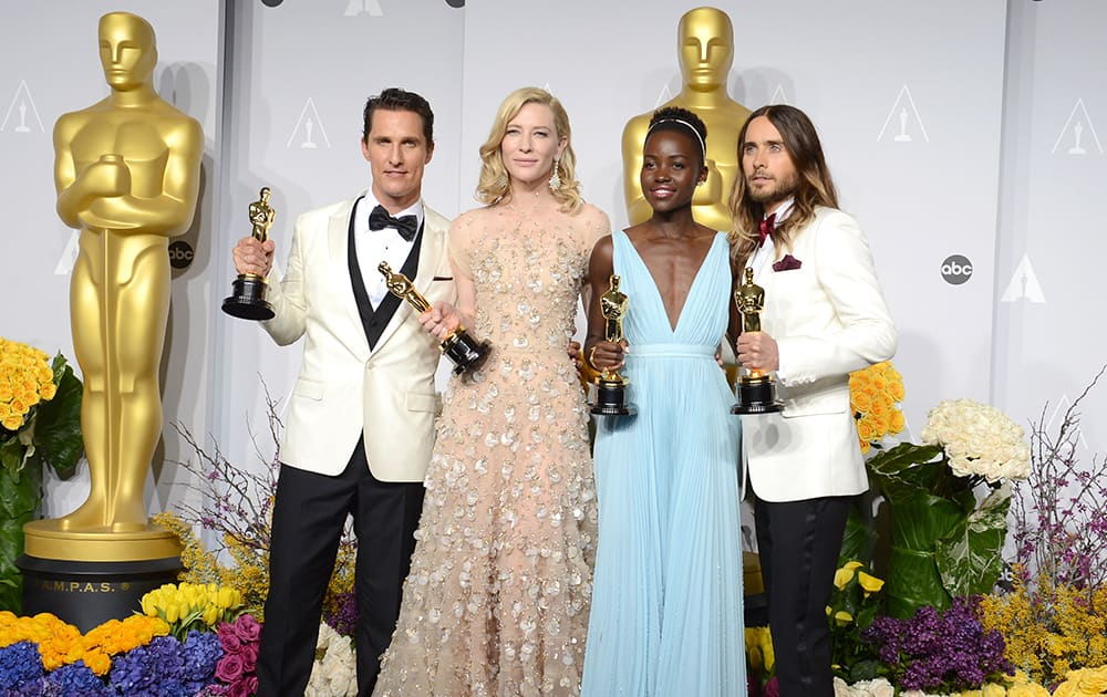 Matthew McConaughey, holds his award for best actor for his role in 'Dallas Buyers Club', Cate Blanchett holds her award for best actress in 'Blue Jasmine', Lupita Nyong'o holds her award for best supporting actress for '12 Years a Slave' and Jared Leto holds his award for best supporting actor.