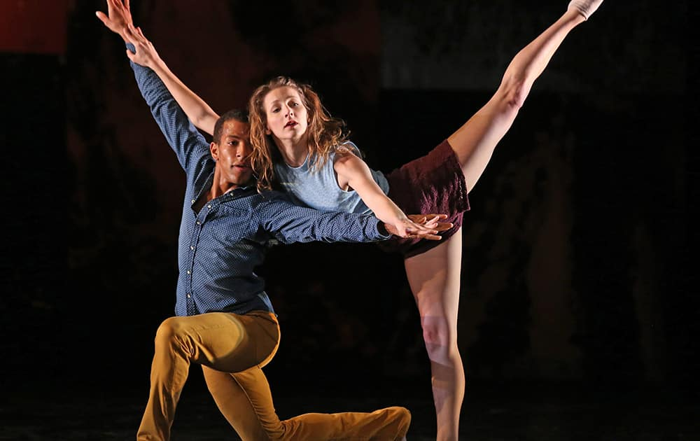 American dancers Anthony Bryant, left, and Rachelle Rafailedes perform on the stage of the Chatelet theatre in Paris, as part of the L.A.