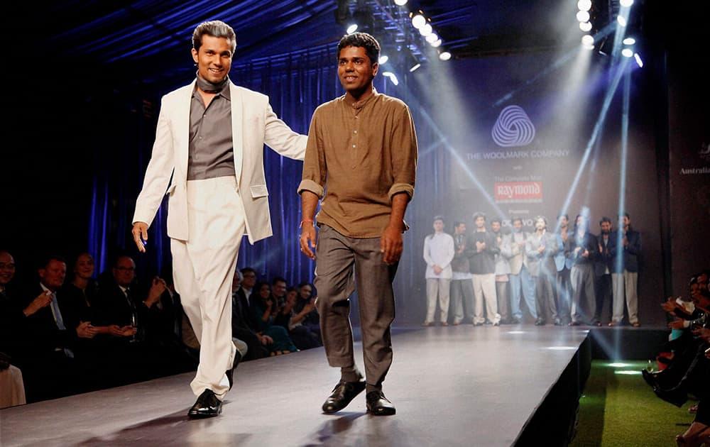Randeep Hooda walks the ramp at a fashion event in New Delhi.
