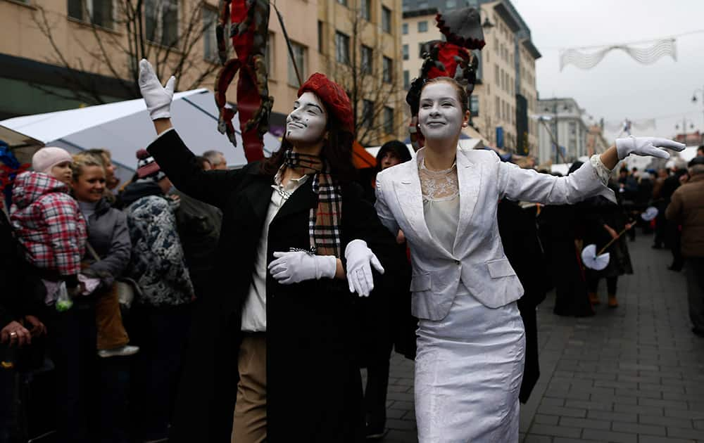 People take part in the theatrical carnival procession during the traditional Kaziukas fair, a large annual folk arts and craft fair in Vilnius, Lithuania.