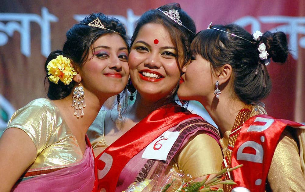 Winners of the Miss Dibrugarh University fashion show competition 2014, pose for a photo in Dibrugarh.