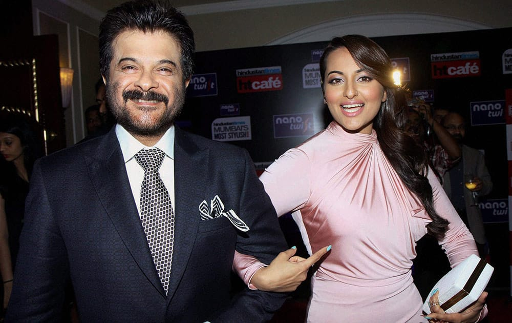 Bollywood actors Sonakshi Sinha with Anil Kapoor poses during an Awards function in Mumbai.