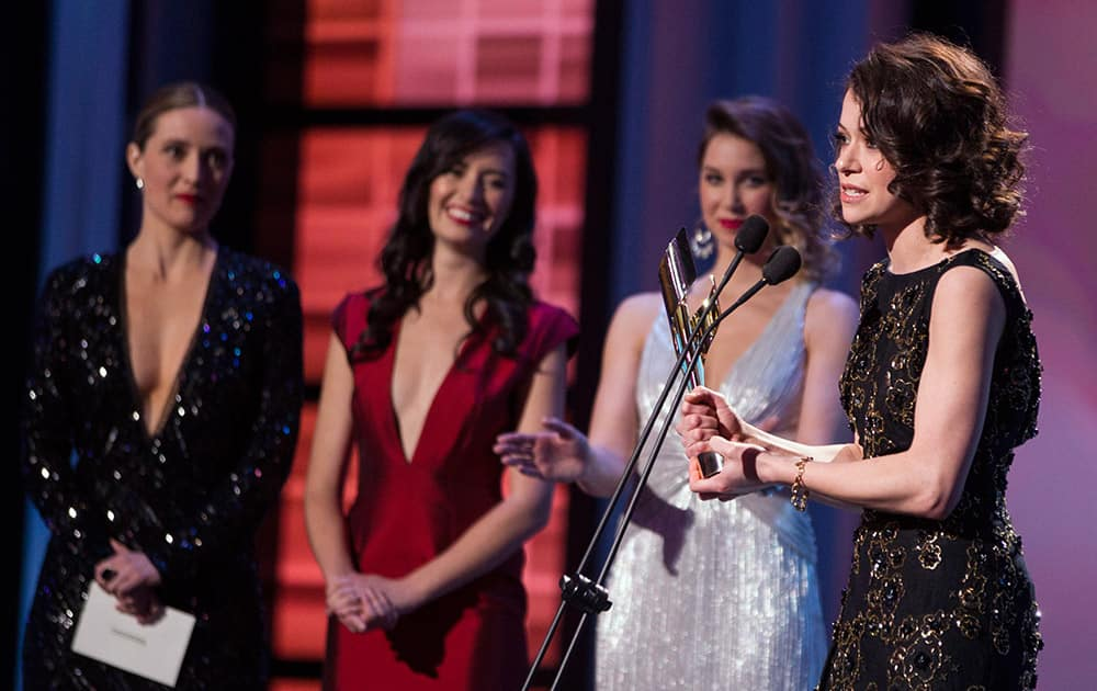 Tatiana Maslany, right, accepts the award for Best Performance by an Actress in a Continuing Leading Dramatic Role for 'Orphan Black' at the Canadian Screen Awards in Toronto.