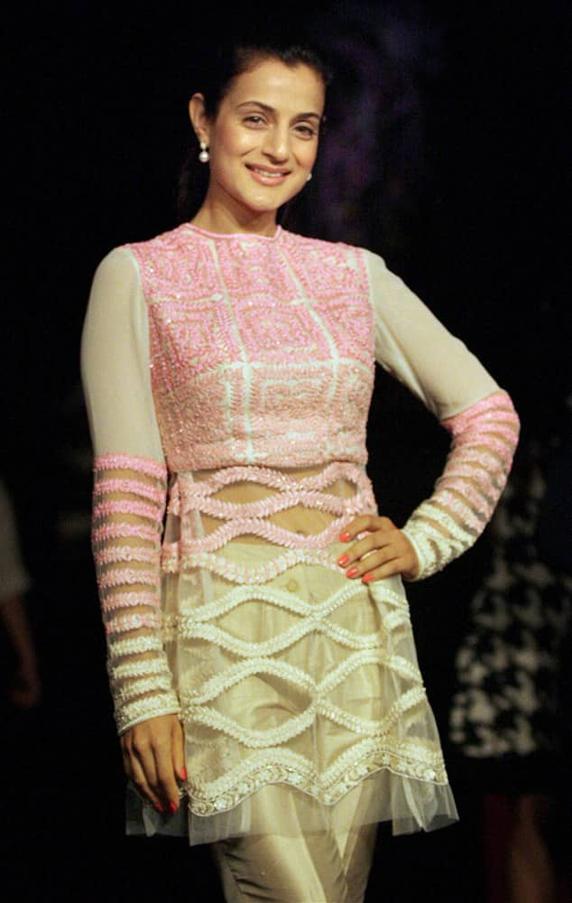 Bollywood Actress Ameesha Patel displays a designer's collection during the opening session of Lakme Fashion Week, in Mumbai.