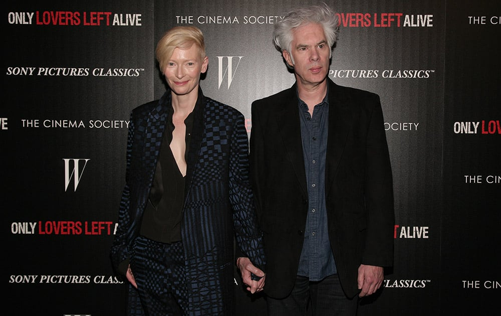 Actress Tilda Swinton, left, and director Jim Jarmusch, attend a screening of `Only Lovers Left Alive` hosted by the Cinema Society and W Magazine in New York.