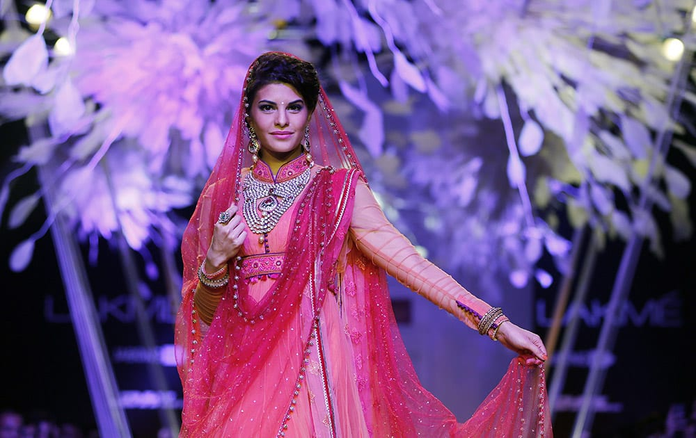 Bollywood actress Jacqueline Fernandez walks the ramp to showcase a creation by Tarun Tahiliani during the Lakme Fashion Week in Mumbai.