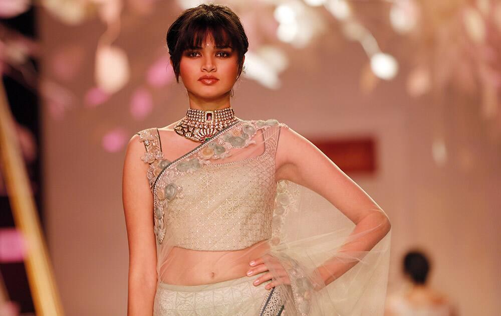 A model walks the ramp to showcase a creation by Tarun Tahiliani during the Lakme Fashion Week in Mumbai.