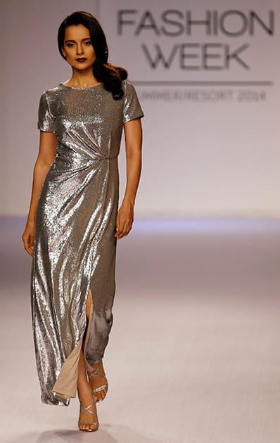 Kangana Ranaut walks the runway to showcase a creation by Dorothy Perkins during the Lakme Fashion Week in Mumbai.