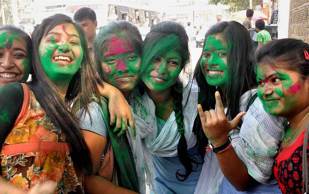 College girls celebrate Holi, the festival of colors in Guwahati.