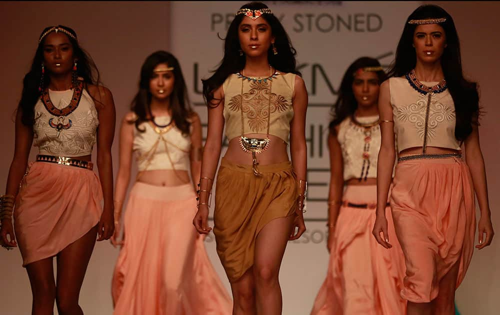 Models display creations by designers Pretty Stoned during the Lakme Fashion Week in Mumbai.