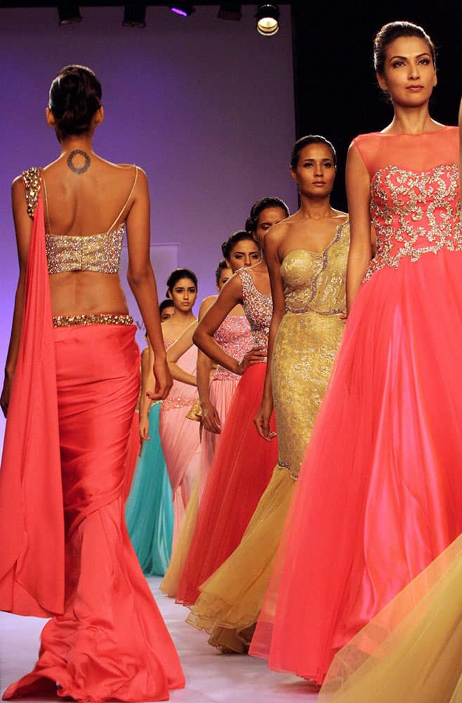 Models walk the ramp during the Lakme Fashion Week 2014 in Mumbai.