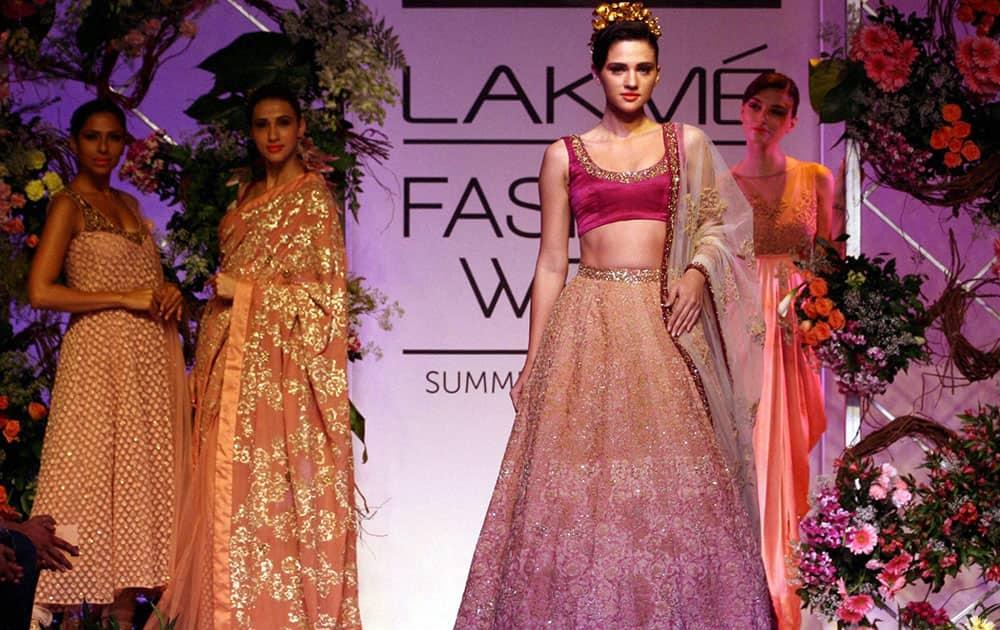Models walk the ramp during the Lakme Fashion Week (LFW) 2014 in Mumbai.