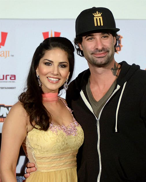 Indo-Canadian actress Sunny Leone with husband Daniel Weber after a press conference to promote her upcoming film 'Ragini MMS 2' in Bhopal.