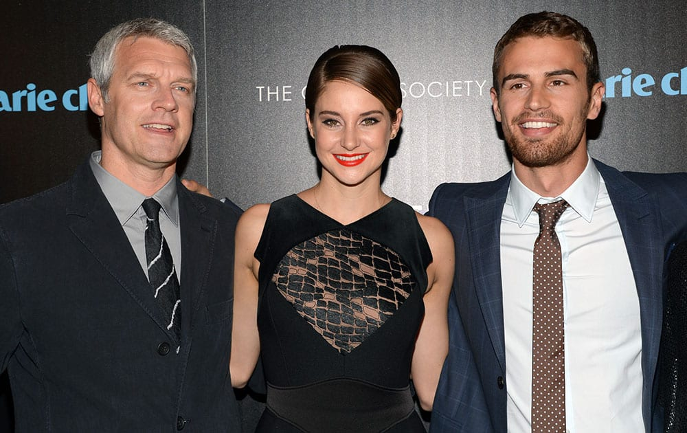 Director Neil Burger, actress Shailene Woodley and actor Theo James attend a special screening of 'Divergent' hosted by Marie Claire and The Cinema Society at Hearst Tower, in New York.