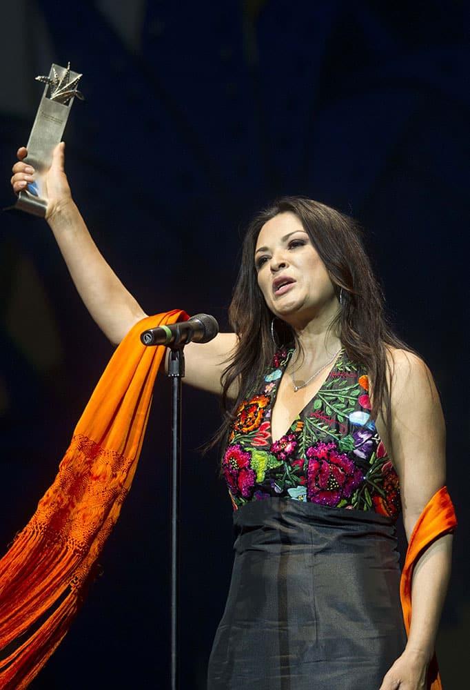 Mexican American film actress Elpidia Carrillo speaks after being awarded the `Guadalajara Latino` prize during the Guadalajara International Film Festival in Guadalajara, Mexico.