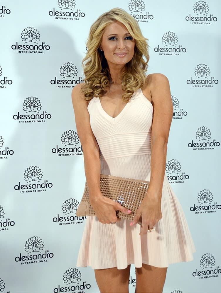 US singer,and actress Paris Hilton poses at a booth at Beauty Duesseldorf in Duesseldorf, Germany.