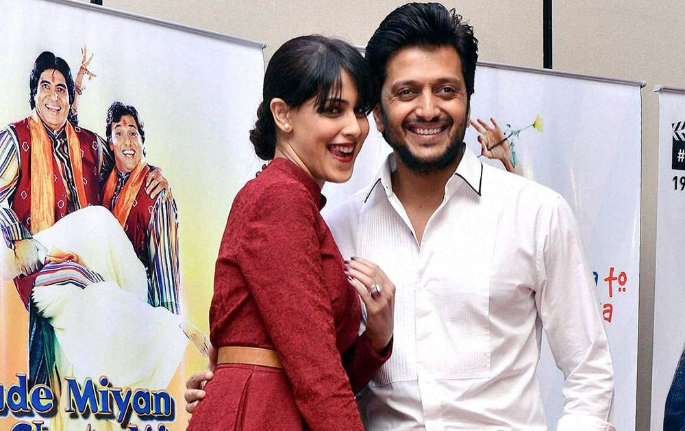 Bollywood actor Riteish Deshmukh with his wife and actress Genelia D'Souza during the 25th movie celebration of filmmaker Vasu Bhagnani in Mumbai.