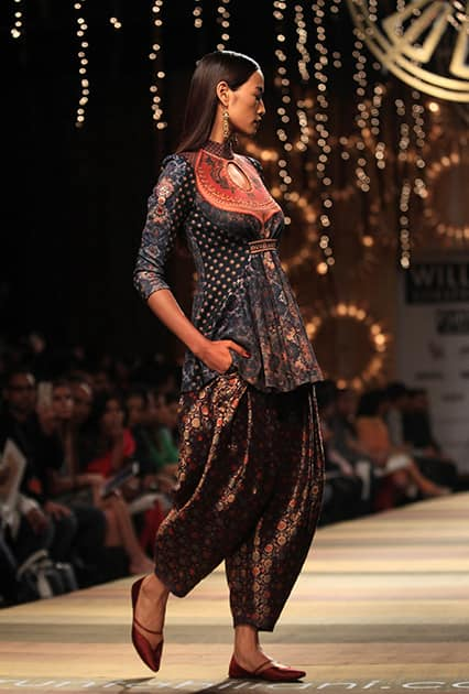 A model displays a creation by Tarun Tahiliani during the Wills lifestyle Fashion Week in New Delhi.