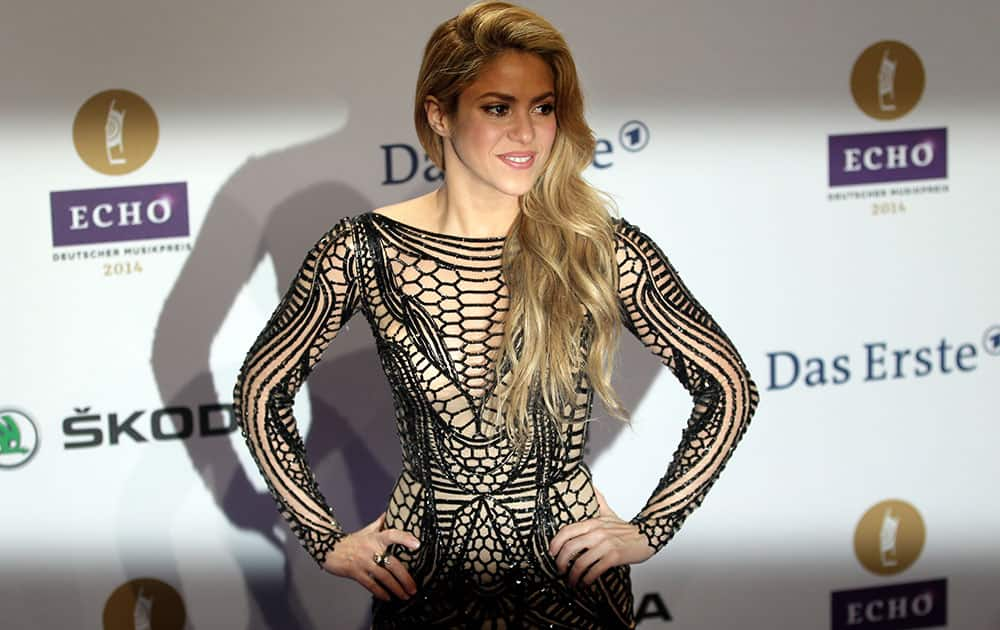 Singer Shakira from Columbia poses for the photographers as she arrives for the Echo 2014 music awards show in Berlin, Germany.