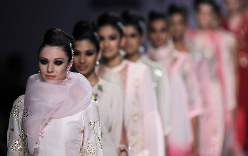 Models display creations by Nikasha during the Wills Lifestyle Fashion Week in New Delhi.