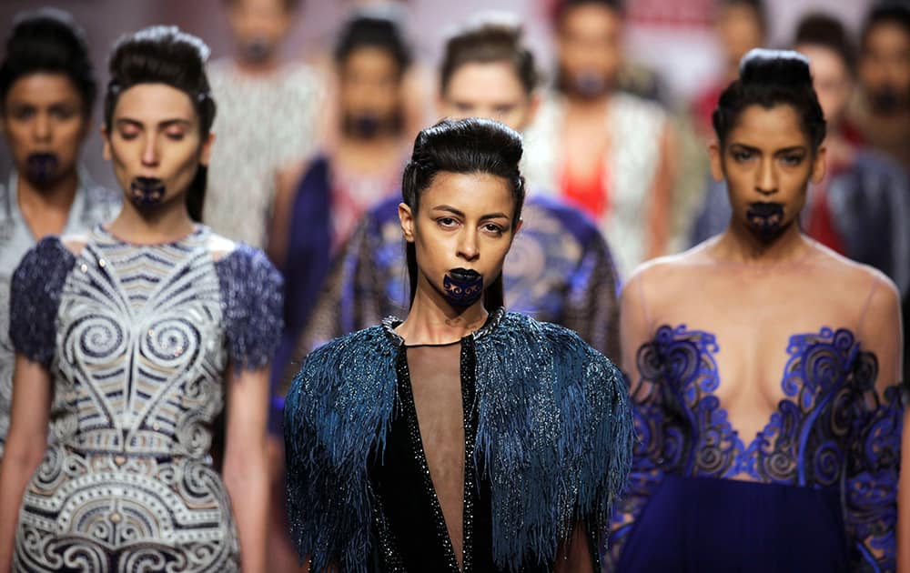 Models display creations by Nachiket Barve during the Wills Lifestyle Fashion Week in New Delhi.