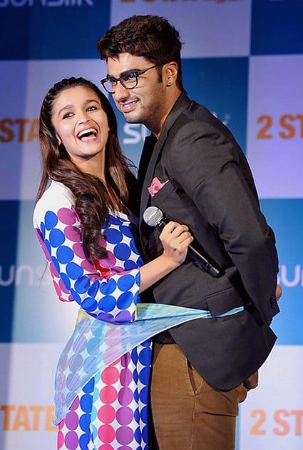 Bollywood actors Arjun Kapoor and Alia Bhatt during promote their upcoming film '2 States' in Mumbai.