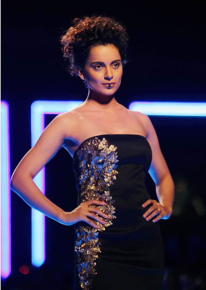 Bollywood actor Kangana Ranaut display a creation by Namrata Jaoshipura during the Grand Finale of Wills lifestyle Fashion Week in New Delhi.