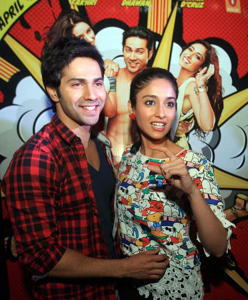 Bollywood actors Varun Dhawan, Ileana D'Cruz, pose for photographs during promotion of their film Main tera hero, in Lucknow.