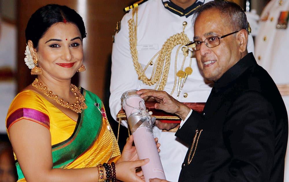 President Pranab Mukherjee presents Padma Shri to actress Vidya Balan during Padma Awards 2014 at Rashtrapati Bhavan in New Delhi.