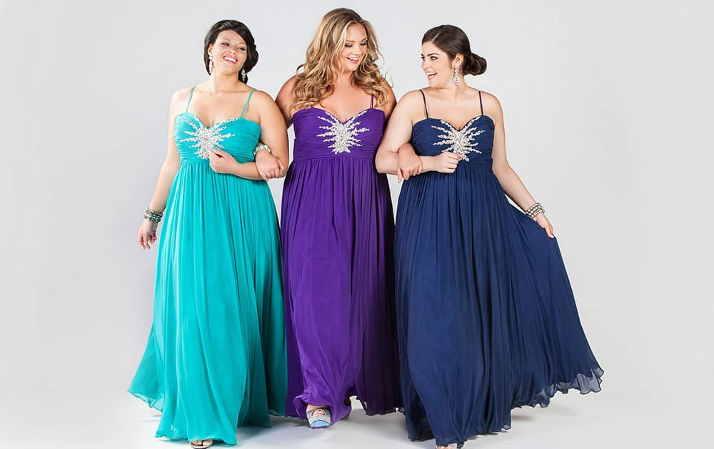 This product image released by Sydney's Closet shows women modeling plus size prom dresses.
