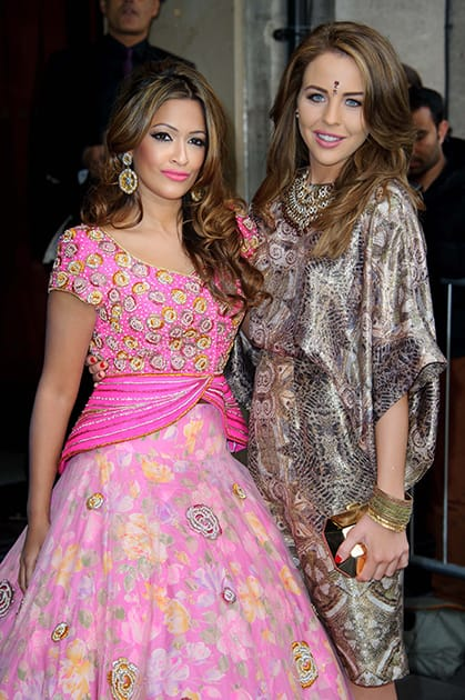 British presenter Tasmin Lucia Khan, left, and British actress Lydia Bright arrive for the Asian Awards at a central London venue, London.