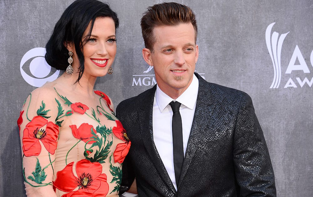 Shawna Thompson, left, and Keifer Thompson, of the musical group Thompson Square, arrive at the 49th annual Academy of Country Music Awards at the MGM Grand Garden Arena in Las Vegas.