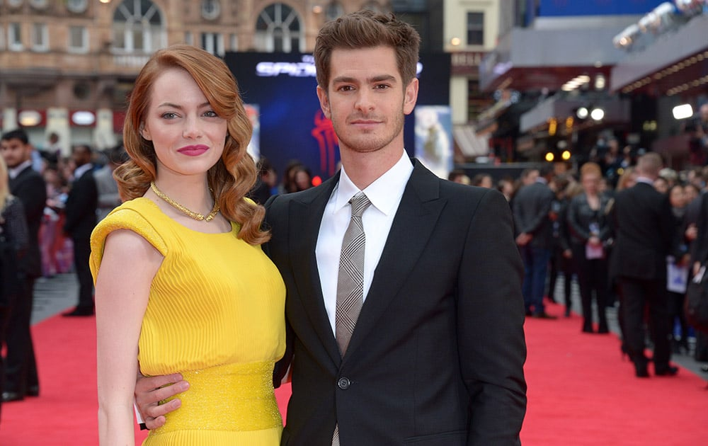 US actress Emma Stone and British actor Andrew Garfield pose for photographers as they arrive on the red carpet for the world premiere of The Amazing Spider-Man 2 in Leicester Square, London.