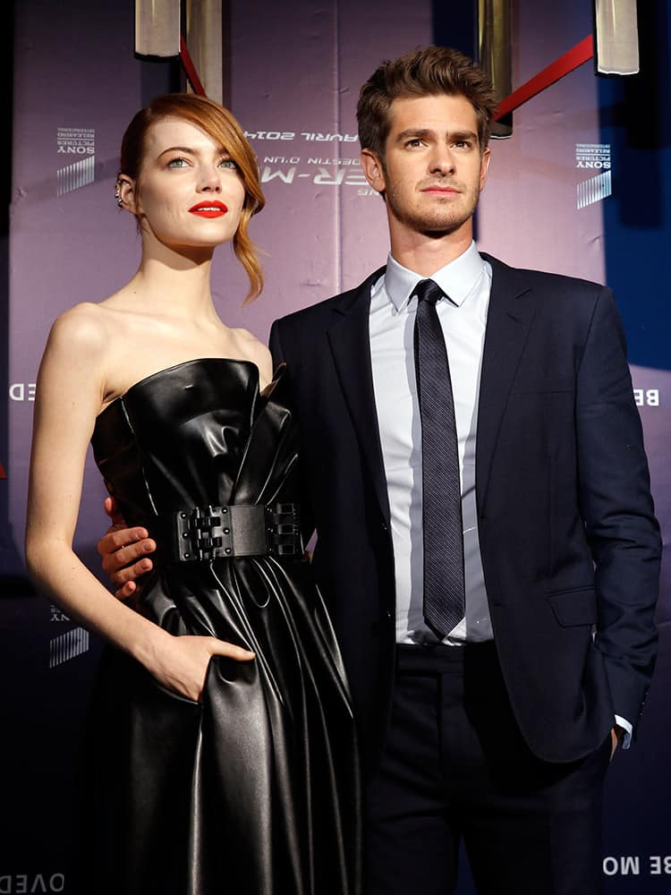 British actor Andrew Garfield and US actress Emma Stone pose for photographers before the French premiere of the movie The Amazing Spider-Man 2, in Paris.
