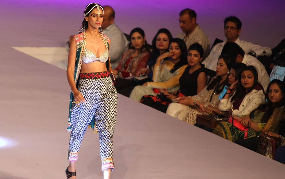 A model displays creation by designer Karma Pink at a fashion show organized by the Pakistan Fashion Designers Council in Lahore.