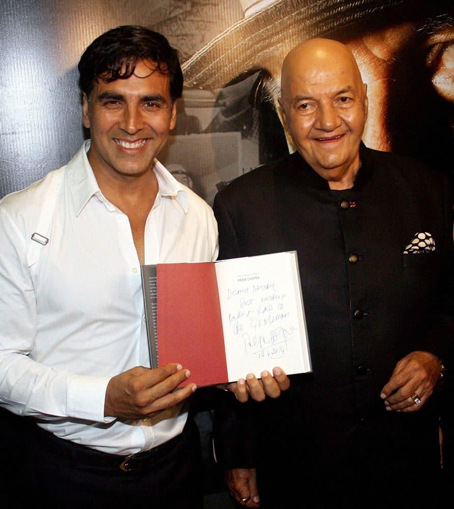 Actor Akshay Kumar during the launch of 'Prem Naam Hai Mera, Prem Chopra' a biography on Veteran actor Prem Chopra (R) in Mumbai.
