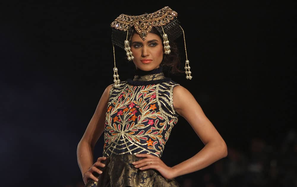 A model displays a creation by designer Akif Mahmood at a fashion show organized by the Pakistan Fashion Designers Council in Lahore.