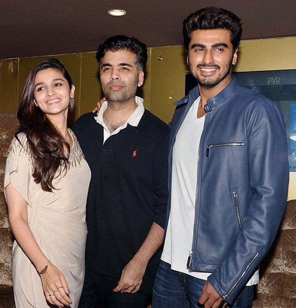 Bollywood director Karan Johar, actors Alia Bhatt and Arjun Kapoor during the promotion of their film '2 States' at a movie hall in Mumbai.