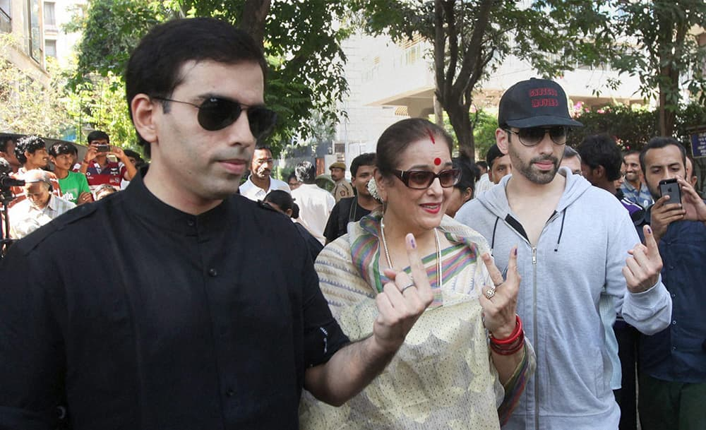 Bollywood actor Shatrughan Sinha's wife Poonam and sons Luv and Kush after casting their votes for Lok Sabha elections in Mumbai.