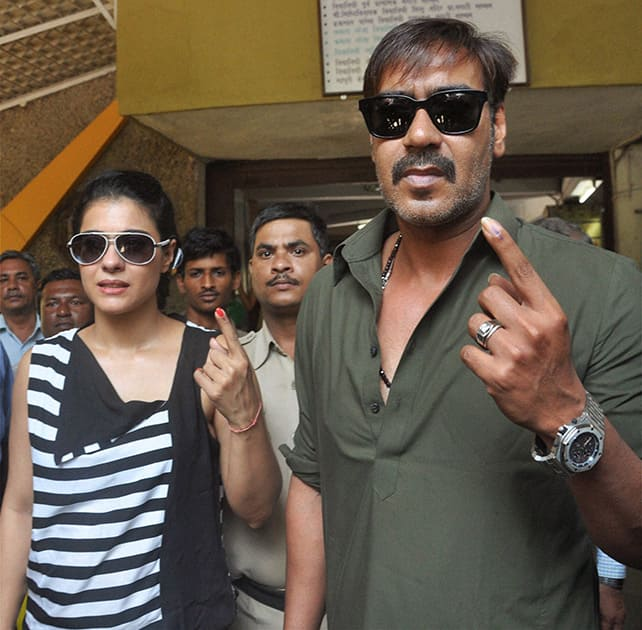 Bollywood actors Ajay Devgn with wife Kajol after casting their votes during the Lok Sabha elections 2014 in Mumbai.