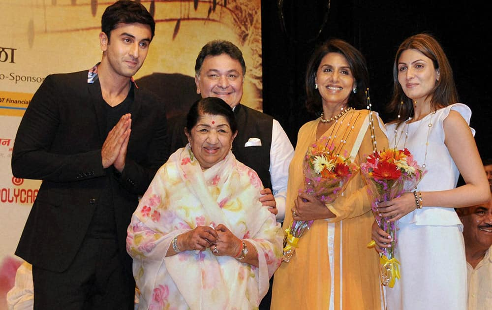 Legendary singer Lata Mangeshkar along with actor Rishi Kapoor and his family members Ranbir (L) Ridhima (R)and Neetu Kapoor (2nd R) at a function on the occasion of Dinanath Mangeshkar's 72nd death anniversary in Mumbai.